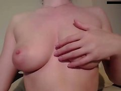 Solo submissive slut clamps her boobs