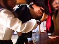 Two beautiful Japanese schoolgirls finger each other's achi