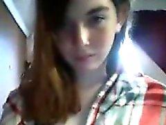 Sexy redheaded teen schoolgirl teases on webcam