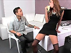 Female agent plays with banana and cock