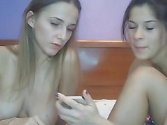 Lesbian Couple Taking Selfie while Licking Pussy