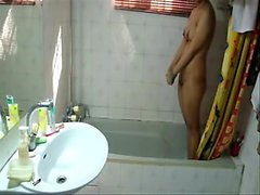 A beautiful big boobed slim girl is taking a bath in