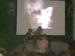 Hot interracial threesome in the cinema