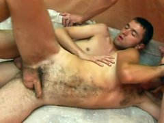 Hairy young dude gets spit roasted in this smoking hot gay action