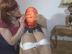 Shemale tranny bound, gagged blindfolded with scarfs