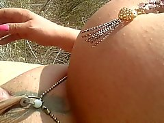 Castrated sissy at the nude beach