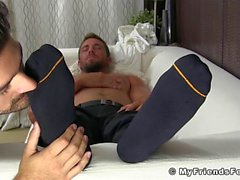 Hunky businessman feet worshiped while jerking off