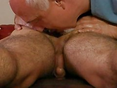 Older gay gives muscled stud a cock massage