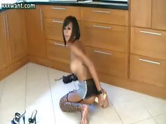 Ebony shemale riding a dildo in the kitchen