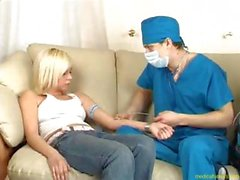 Two horny doctors in scrubs examine a blonde patient thoroughly