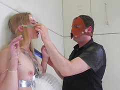 Hot blond gets bagged, suffocated, and face fucked at office