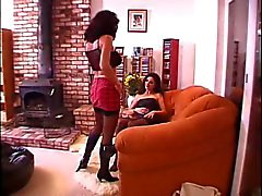 Brunette lesbian lays on sofa and girlfriend licks her pussy