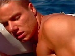 Fervent anal pumping on the yacht with muscled studs