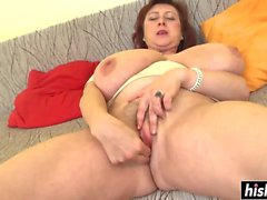 Busty brunette girl plays with a dildo