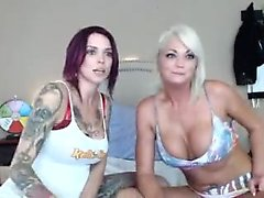 Hot blonde milf is licked by a brunette lesbian