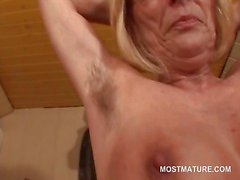 Kinky mature in glasses stripping and teasing her boobies