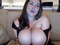 Blue eyed showing her giant boobs