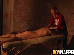 Tied up twinkie receives a blowjob and tugjob from master