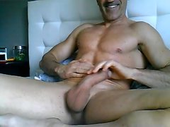 Sexy gay jerks off dick