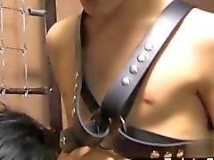 Leather bond twink face fucks his slave
