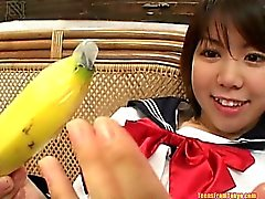 Asian teen with a banana