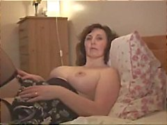Busty mature strips down and shows off her pussy on webcam
