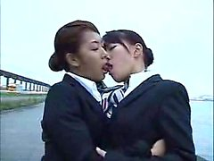 Elegant Oriental babes get together for a passionate lesbia
