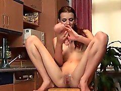 Peeing in her kitchen