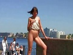 Sexy Lilu shows off her shaved cunt on public