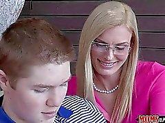 MILF stepmom shows boy how to lick pussy