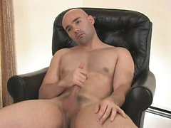 Bald guy gets his dick hard and storkes it just for you