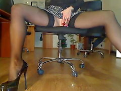 Sexy office play in stockings behind boss