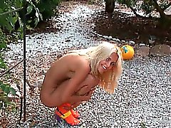 Hot outdoor stripping by sexy blond babe