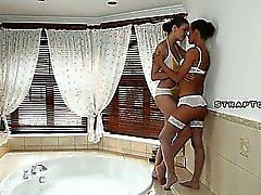 Lesbians drinking and fucking in hot tub