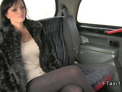 Busty British hooker fucks in a cab
