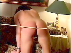 Naughty brunette babe has to bend over and get her ass whipped
