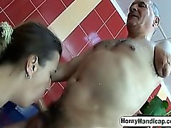 Handicapped guy fucks brunette MILF in the bathroom