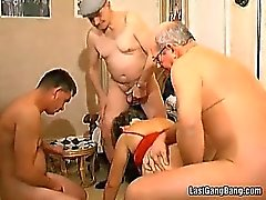 Old slut takes three cocks