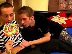 Cute twinks share lollipop before licking each other after