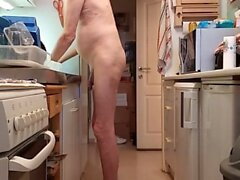washing my dishes naked in the kitchen
