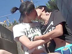 Gay asian twinks kissing outdoors