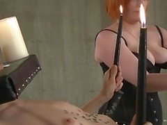 Slutty slave gets covered in candle wax