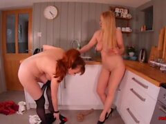 'Red XXX and her naughty girlfriend fuck in the kitchen'