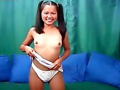 Asian lollipop girl shows her hairy pussy.